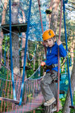 Boy climbing in adventure park , rope park Royalty Free Stock Image