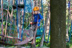 Boy climbing in adventure park , rope park Royalty Free Stock Photos