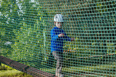 Boy climbing in adventure park , rope park Stock Images