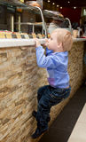 A boy is climbing on the bar Stock Images