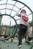 Boy climbing Royalty Free Stock Image