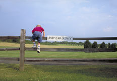 Free Boy Climbing Fence Stock Photos - 6020513