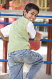 Boy on climbing frame Royalty Free Stock Photo