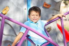 Boy On Climbing Frame In Park Royalty Free Stock Photography