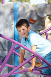 Boy On Climbing Frame In Park Stock Images
