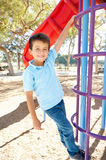 Boy On Climbing Frame In Park Stock Photo