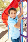 Boy On Climbing Frame In Park Stock Image
