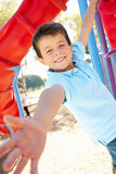 Boy On Climbing Frame In Park Stock Photos