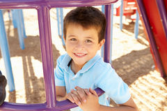 Boy On Climbing Frame In Park Stock Photography
