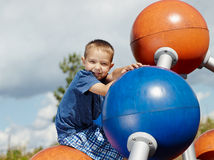 Boy and climbing frame Stock Images