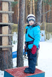 Boy in climbing gear, woods, winter Royalty Free Stock Photos