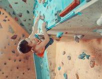 Boy climbing in gym Stock Photos
