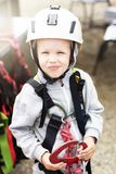 Boy in a climbing helmet stock images