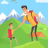 Boy climbing with his father in mountains Royalty Free Stock Images