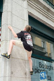 Boy climbing a house wall on street boulder contest Royalty Free Stock Photo