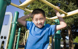 Boy Climbing on Jungle Gym - Horizontal Stock Photo