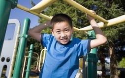 Boy Climbing on Jungle Gym - Horizontal Stock Photo