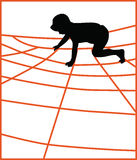 Boy climbing a jungle gym net Stock Image