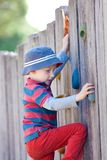 Boy climbing Royalty Free Stock Image