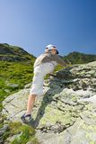 Boy climbing on mountain. Young boy climbing up on a mountain Royalty Free Stock Images