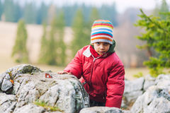 Boy climbing on mountain rocks Royalty Free Stock Photography