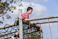 Boy Climbing Netting Playground Stock Image