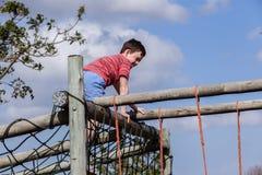 Boy Climbing Netting Playground Stock Photo