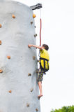 Boy climbing a rock wall Royalty Free Stock Photography