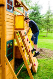 Boy Climbing Rock Wall Playhouse Stock Images