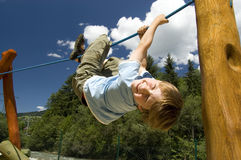 Boy On Climbing Rope Royalty Free Stock Photos
