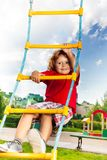 Boy climbing on rope ladder Stock Photo
