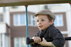 Boy climbing a rope ladder Royalty Free Stock Photography