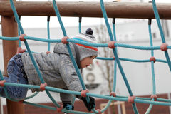 Boy climbing on rope Royalty Free Stock Photography