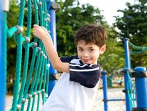 Boy on climbing rope in playground Royalty Free Stock Photos