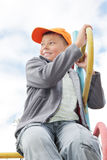 Boy on climbing staircase looking sideways Royalty Free Stock Photography