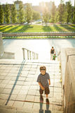 Boy climbing stairs Stock Photo