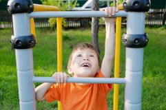 Boy climbing stairs and playing outdoors on playground, children activity. Child having fun. Active healthy concept Stock Photography