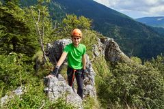 Boy climbing on via ferrata Royalty Free Stock Photo