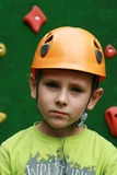 Boy and a climbing wall Stock Image