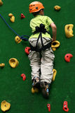 Boy on climbing wall Stock Photos