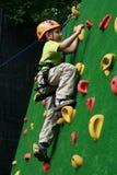 Boy on climbing wall Stock Photography