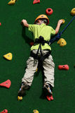 Boy on climbing wall Stock Photography