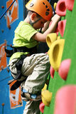 Boy on climbing wall Stock Photo