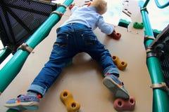 Free Boy Climbs Royalty Free Stock Photos - 52216468