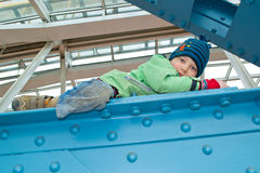 Boy climbs on the bridge Stock Photography