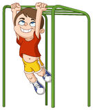Boy climbs monkey bars Stock Photo