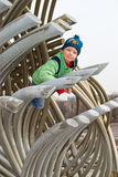 A boy climbs on a pipe Stock Image