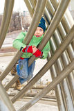 A boy climbs on a pipe Stock Photography