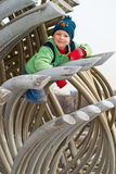 A boy climbs on a pipe Royalty Free Stock Photography