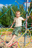 The boy climbs the ropes Royalty Free Stock Image